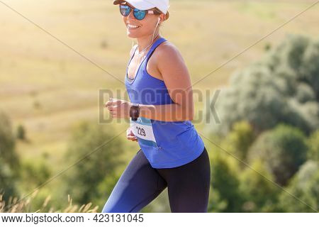 Young Slim Fitness Girl Running Trail Cross Race