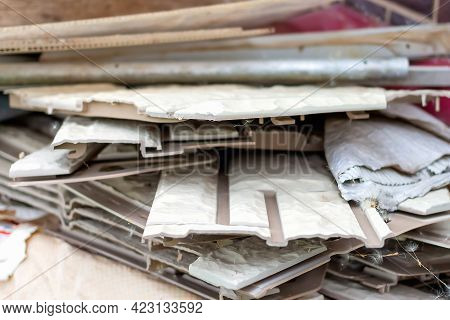 Soft Focus Of Broken Plastic Panels For Home Decoration Lying On The Ground. Abandoned Construction