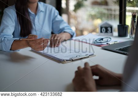 Employer Reviewing Good Cv Of Prepared Skilled Applicant. Hr Manager Making Hiring Decision. Intervi