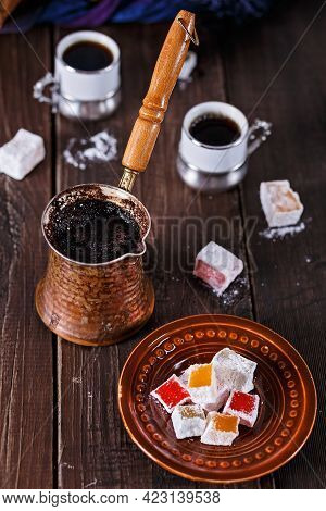 Turkish Coffee And Turkish Delight On Rustic Dark Wooden Background. Selective Focus, Shallow Depth