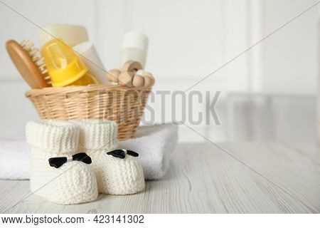 Baby Booties And Accessories On White Wooden Table Indoors. Space For Text