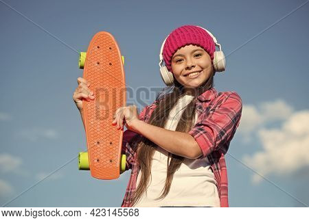 Happy Girl Child Hold Penny Board Listening To Music In Headphones Sunny Sky Outdoors, Transportatio