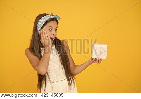 Gift Shop Advertising. Surprised Child Hold Wrapped Box. Presenting Holiday Gift. Advertising Produc