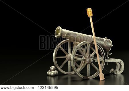 An Old Cannon Has Rust On Carriage And Cannonballs Beside It Against A Black And Dark Background. A