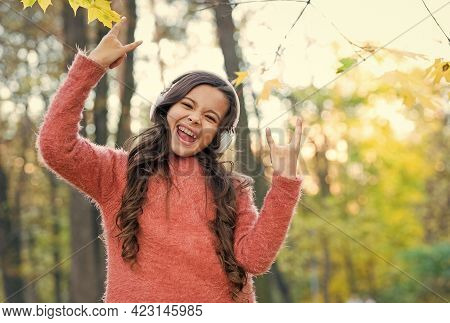 Going Crazy. Child Listen Music In Fall Forest. Enjoy Elearning In Headset. Kid Wear Sweater In Autu