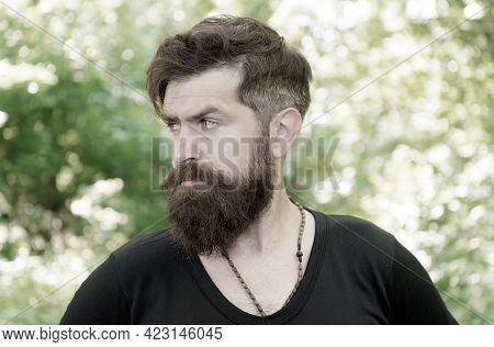 Wilderness Survival Guide. Man Bearded Hipster Bright Foliage Background. Guy Relax In Summer Forest