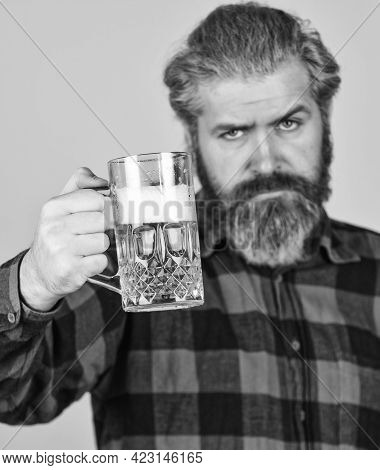 Hipster At Bar Counter. Having Fun Watching Football. Brutal Bearded Male Drinks Beer From Glass. Be