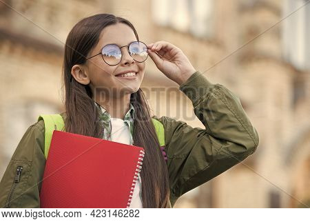Happy Kid Fix Eyeglasses To See Better Holding School Book Autumn Outdoors, Eyesight