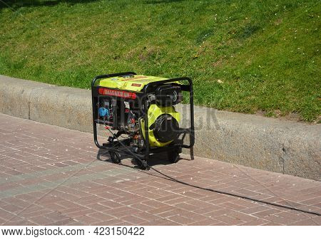 Kyiv, Ukraine - May, 17, 2020: Outdoor Power Equipment, A Portable Gasoline Generator Working Outdoo