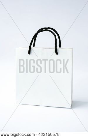 Blank Paper White Bag On White Background. Black Friday Sale. Shopping Concept. Mockup Of Paper Shop