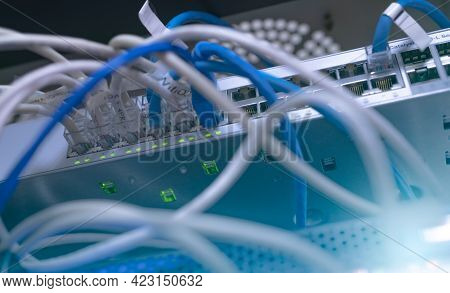Network Switch And Ethernet Cable In Data Center. Wifi Plug Of Internet Router For Computer. Network