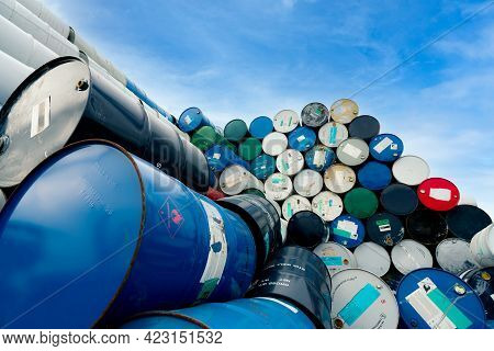 Old Chemical Barrels. Blue Oil Drum With Flammable Liquid Symbol. Toxic Waste Warehouse. Hazard Chem