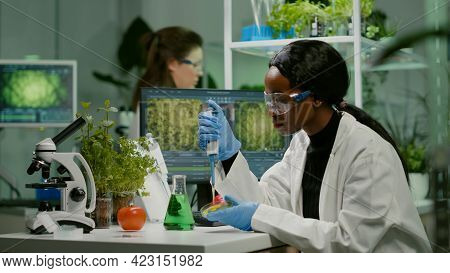 Biologist Scientist African Woman Researcher Taking Genetic Solution From Test Tube With Micropipett
