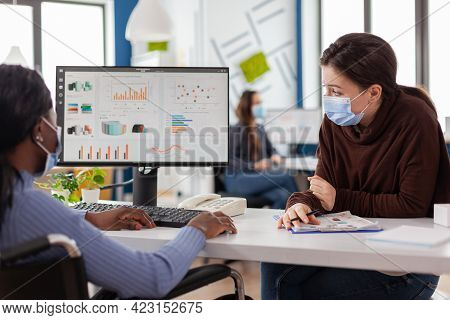 Immobilized Handicapped Invalid African Entrepreneur Working With Colleague In New Normal Business O