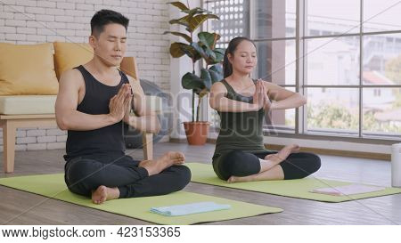 Happy Asian Beautiful Lifestyle Family Couple Doing Yoga Sitting Meditating On Lotus Pose Workout At