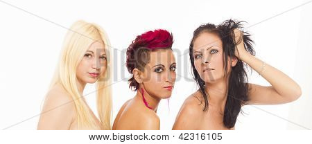 Three beautiful sexy lesbian woman posing close tot each other on white isolated studio background