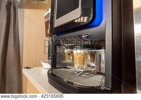 Hot Delicious Coffee Beans With Milk, Freshly Made In A Coffee Machine