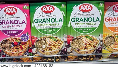 Samara, Russia - June 6, 2021: Axa Premium Granola Crispy Muesli In Assortment On The Store Shelf