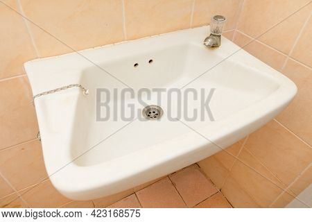 The Old Washbasin In The Bathroom Is Dirty