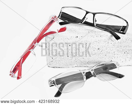 Three Various Eyeglasses On Trendy Stone. Optical Store, Glasses Selection, Eye Test, Vision Examina