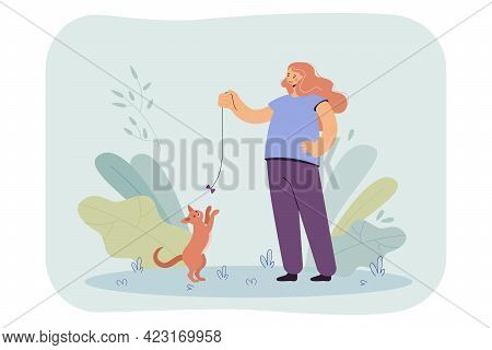 Happy Girl Playing With Cat With Bow Flat Vector Illustration. Teenager Standing On Lawn, Having Fun