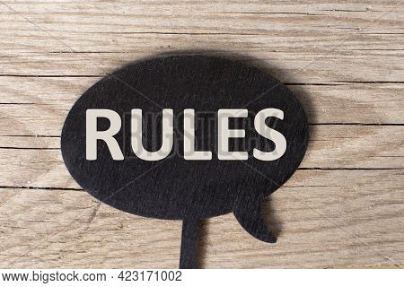 Black Board With The Word Rules. Setting Rules, Laws. Legislation.