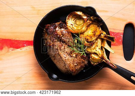 Food Concept Homemade Rustic Honey And Dijon Mustard Pork Tenderloin Roasted In Skillet Iron Pan Wit