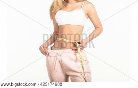 Slim Girl With Centimeter. Closeup Woman Measuring Her Waist With Tape. Slim Womans Body. Woman With