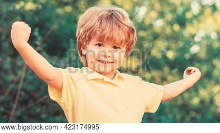 Funny Baby Boy Isolated On A Background Of Green Trees. Smiling Child Boy. Cheerful Cheerful Kid. Ha