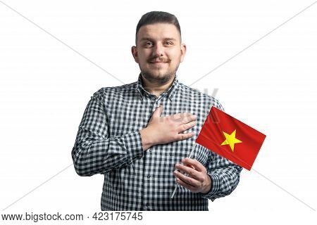 White Guy Holding A Flag Of Vietnam And Holds His Hand On His Heart Isolated On A White Background W