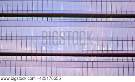 Abstract Closeup Of The Glass-clad Facade Of A Modern Building Covered In Reflective Plate Glass. Ar