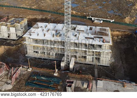 Drone View Of A Large Construction Site. Tower Cranes In Action. Housing Renovation Concept. Crane D