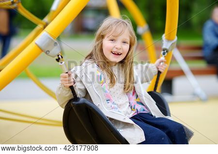 Little Girl Having Fun On Outside Playground. Spring/summer/autumn Active Sport Leisure For Kids. Ch