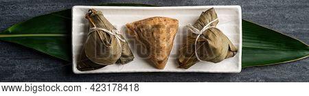 Zongzi. Rice Dumpling Top View For Dragon Boat Festival Over Dark Black Background.