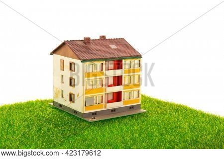 Old miniature apartments in green grass