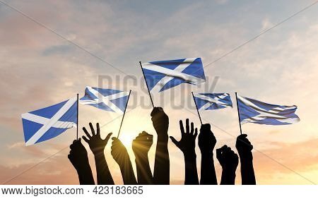 Silhouette Of Arms Raised Waving A Scotland Flag With Pride. 3d Rendering