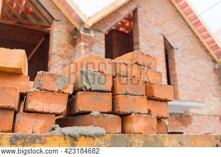 Bricks On The Background Of A Building Under Construction.