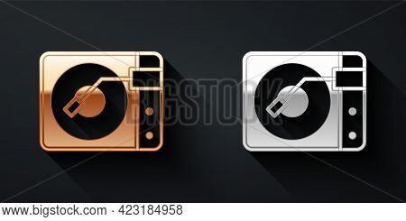 Gold And Silver Vinyl Player With A Vinyl Disk Icon Isolated On Black Background. Long Shadow Style.