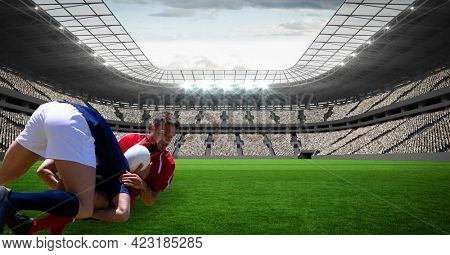Two male rugby players tackling each others against against in background. sports and fitness concept