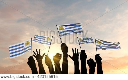 Silhouette Of Arms Raised Waving A Uruguay Flag With Pride. 3d Rendering