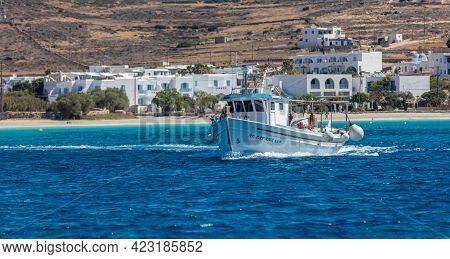 Koufonisi Island, Cyclades, Greece. Sailing Fishing Boat, Village Background.