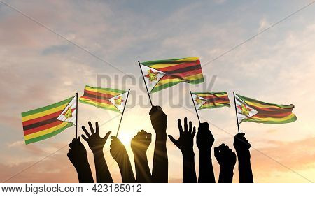 Silhouette Of Arms Raised Waving A Zimbabwe Flag With Pride. 3d Rendering