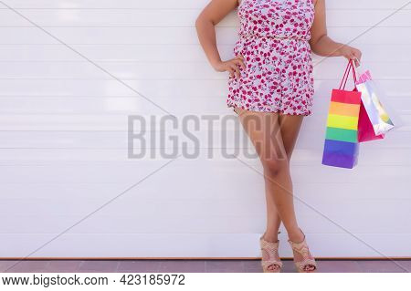 Midsection Of Girl With Shopping Bags. Closeup Of Woman On White Background. Holiday And Shopping Co