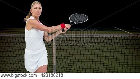 Composition of female tennis player over tennis court on black background. sport and competition concept digitally generated image.
