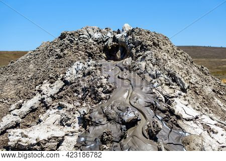 Close Up View On Upper Side Of Mud Volcano. There Is Slow Eruption Of Mud Flow (cold Mix Of Oil, Dir