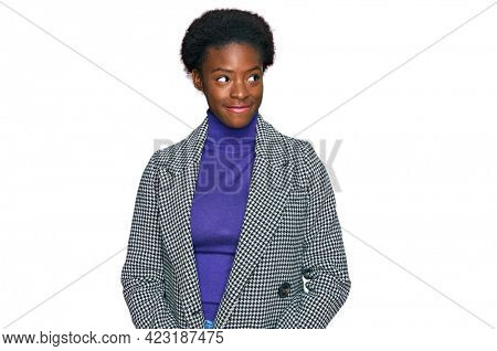 Young african american girl wearing casual clothes smiling looking to the side and staring away thinking.