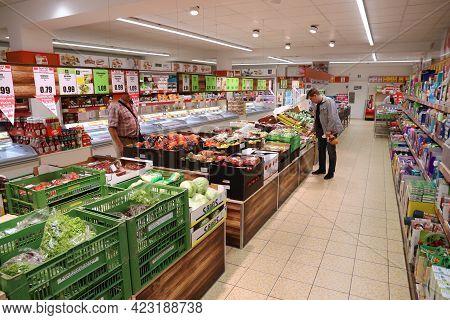 Nuremberg, Germany - May 7, 2018: People Shop In Generic Grocery Shop In Nuremberg, Germany. Total R