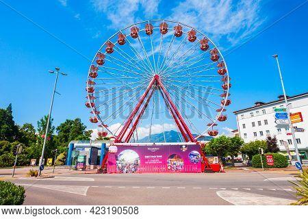 Locarno, Switzerland - July 10, 2019: Ferris Wheel In Locarno. Locarno Is A Town Located On The Shor
