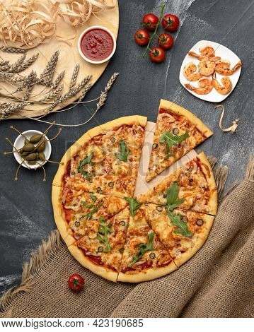 Cutting Italian Seafood Pizza. Flat Lay Food. Ready To Eat Pizza With Prawns Or Shrimps, Arugula, To