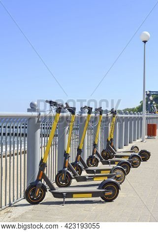Electric Scooters Parked On The Waterfront For Rent